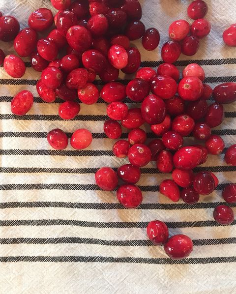 red cranberries scattered across a table