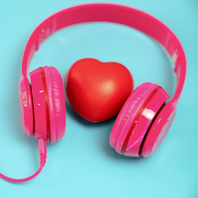 red heart with headphones on blue background