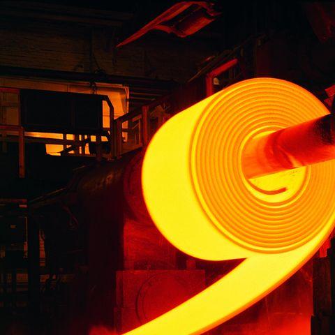 red hot roll of steel in steel mill