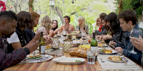 friends around a table full of food for thanksgiving