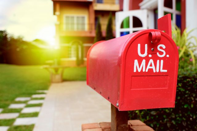 red mailbox and farmhouse