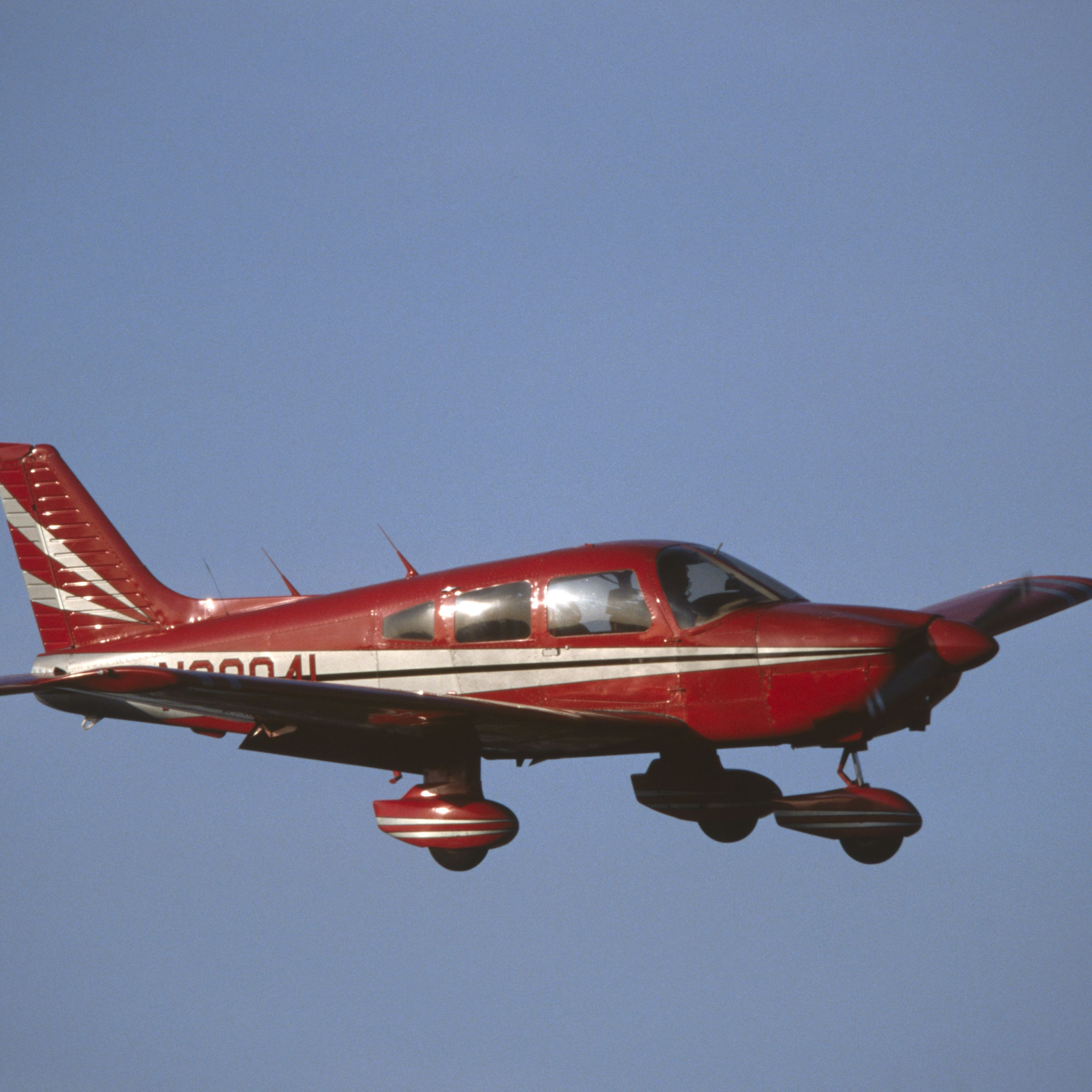 red Piper PA-28 Cherokee flying enroute