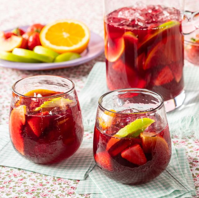 red sangria, two glasses with pitcher and plate of fruit