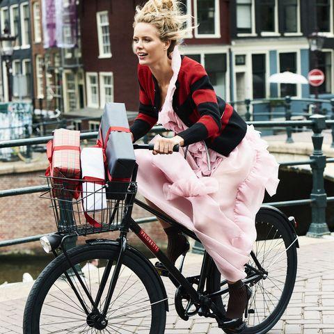 woman on bike with christmas presents