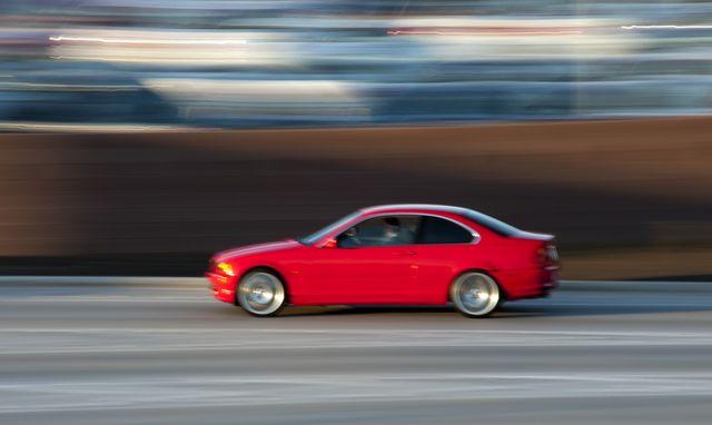red sports sedan, blurred motion