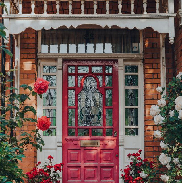 london, uk   may 30, 2020 dark pink stained glass front door of a traditional edwardian house in london, selective focus edwardian houses promote simple design and an appreciation for the handmade