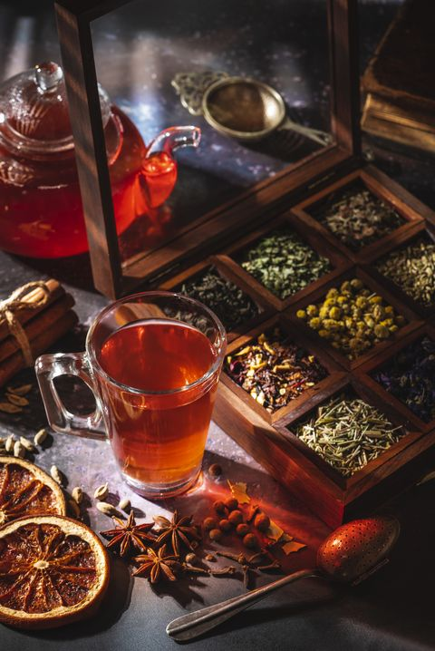 red tea with a box of tea herbs and aromatic spices
