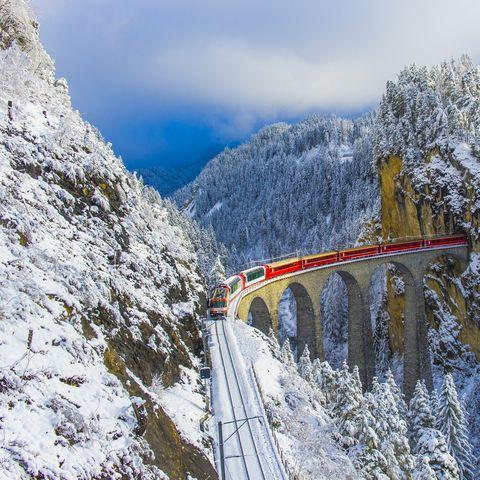 red train in winter wonderland