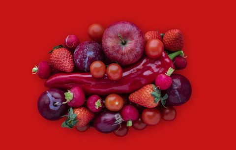Red vegetables on red background