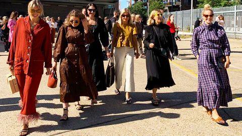 Street fashion, Fashion, Outerwear, Event, Pedestrian, Street, Coat, Fashion design, Pattern, Walking,