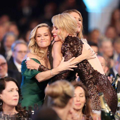 celebrities hugging