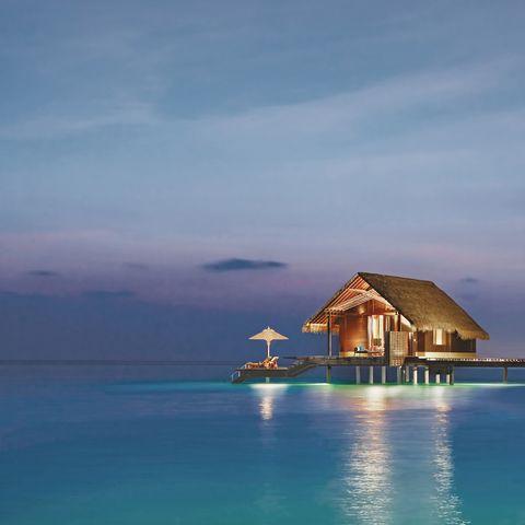 Sky, Sea, Ocean, House, Tropics, Island, Water, Islet, Coastal and oceanic landforms, Calm,