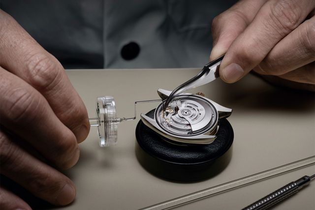 a watch being fixed