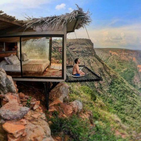 Natural landscape, Wilderness, Sky, Mountain, National park, House, Landscape, Rock, Tree, Geological phenomenon,