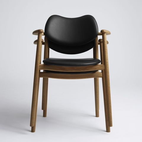 Mid-century style stacked chairs with wooden frame and black leather seat and backrest