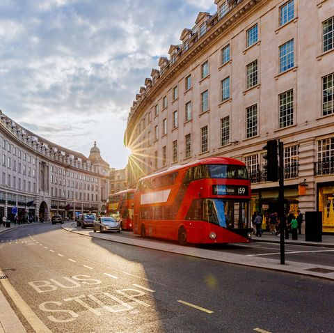 Regent Street  with sun shining through buildings during sunset, London, England, UK