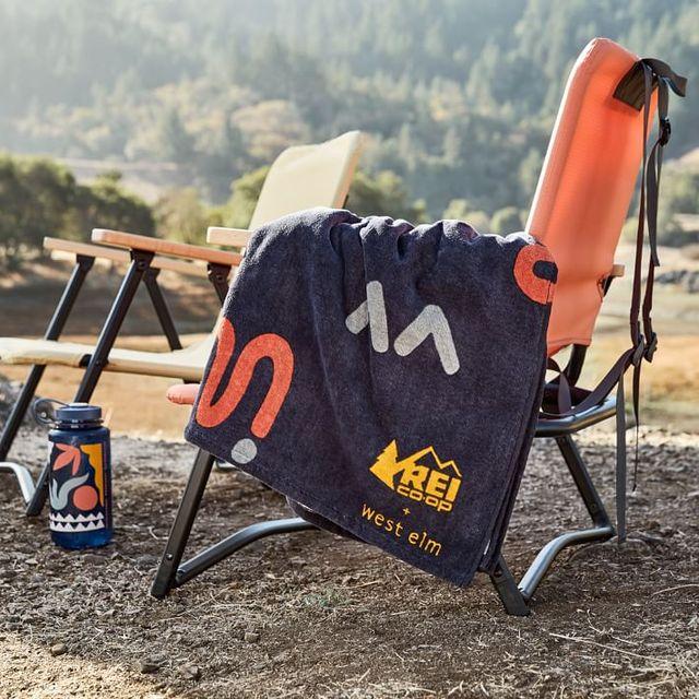 lawn chair, towel, water bottle