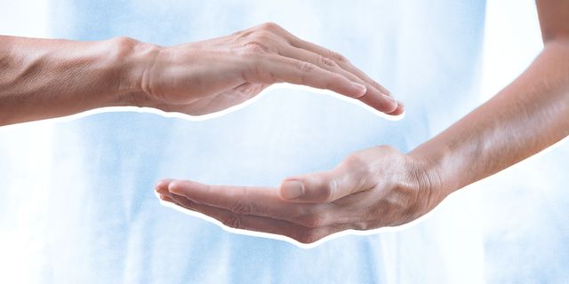 a picture of one hand hovering over another