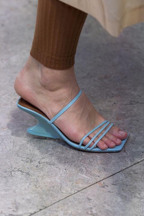 Footwear, Shoe, Sandal, Leg, Ankle, Foot, High heels, Slipper, Human leg, Beige,