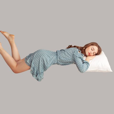 relaxed girl in vintage ruffle dress levitating in mid air, sleeping on stomach lying comfortable cozy on pillow