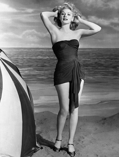 Lucille Ball Modeling Strapless Swimsuit on Beach