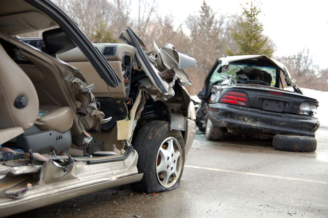 remaining debris of cars involved in a car crash on road