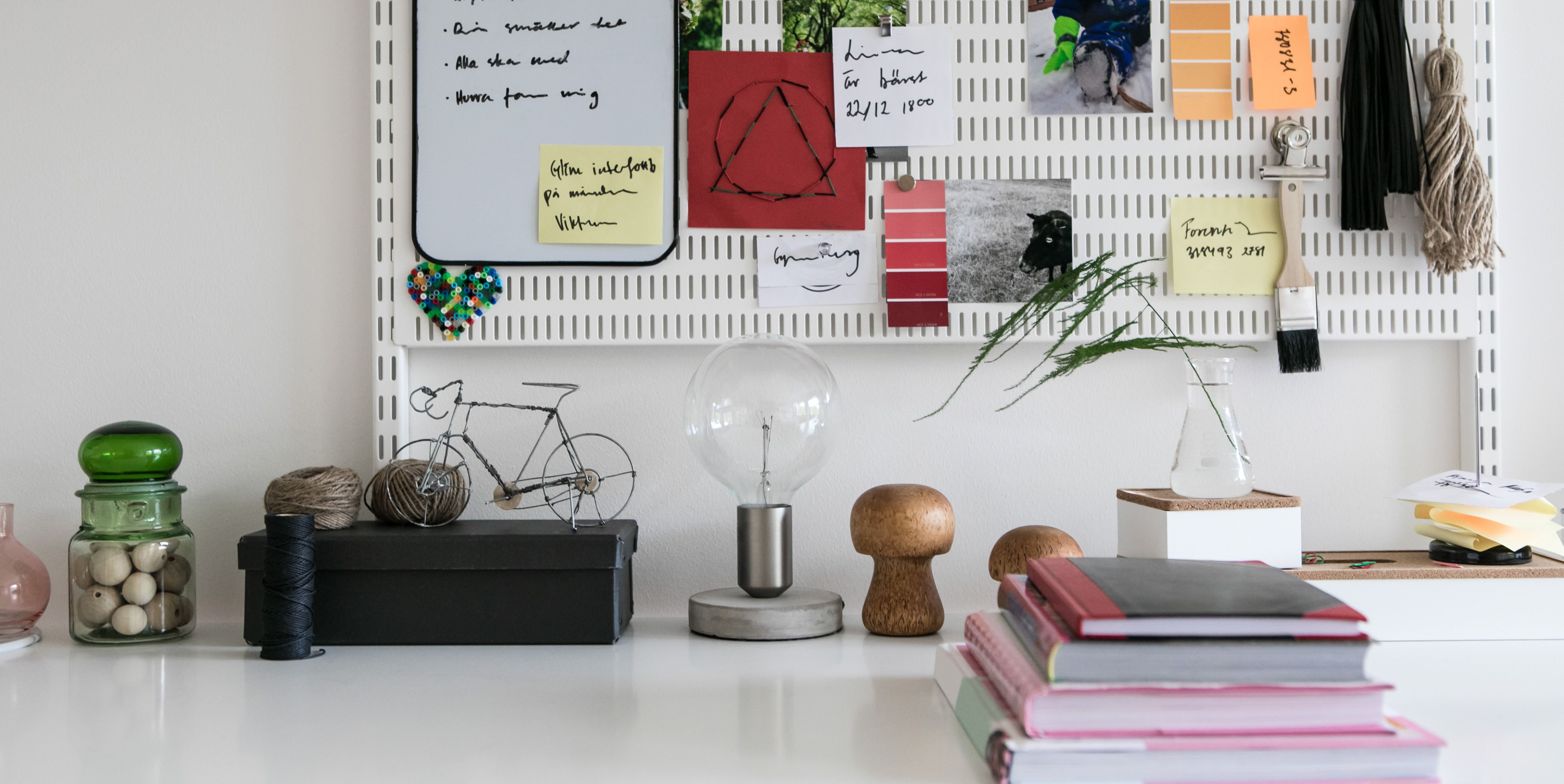 Reminders on pegboard in home office