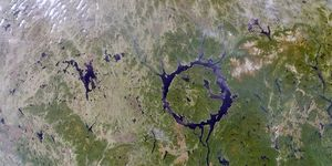 Remnants of one of the largest impact craters still preserved on the surface of the Earth. Occurring about 212 million years ago. Lake Manicouagan in northern Quebec, Canada. June 1, 2001.