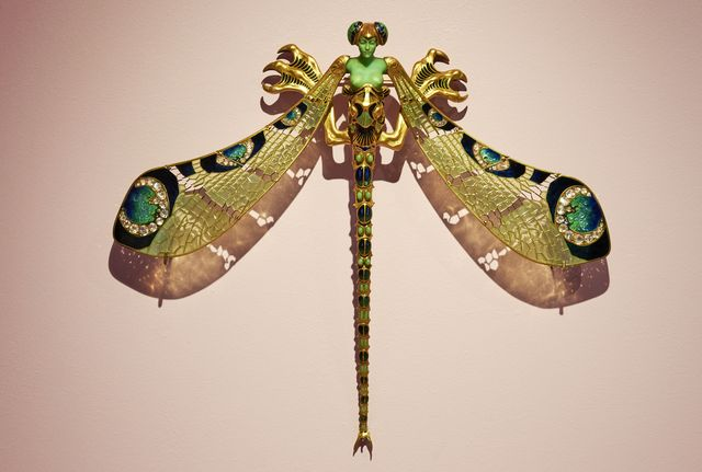 """lisbon, portugal   october 29 """"dragonfly woman"""" art nouveau brooch made of gold, enamel, chrysoprase, diamond and moonstone, on display at the """"rené lalique e a idade do vidro, arte e indústria"""" during the covid 19 coronavirus pandemic on october 29, 2020 in lisbon, portugal three decades after the last exhibition entirely dedicated to french glass designer rené lalique 1860 1945, the gulbenkian foundation exhibits a hundred pieces from the artist's extraordinary glass production, including jewelry, decorative pieces and objects for daily use in addition to pieces belonging to the gulbenkian museum this exhibition includes a set of works from the lalique museum wingen sur moder and some of the most important international private collections photo by horacio villaloboscorbiscorbis via getty images"""