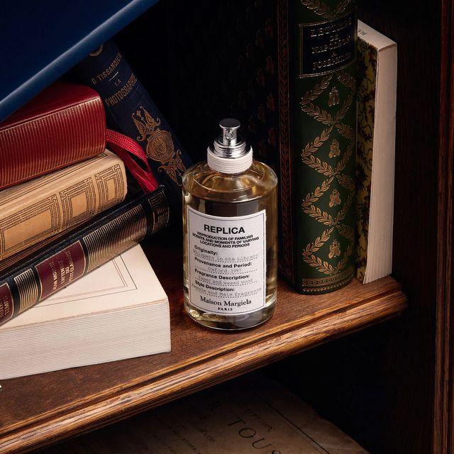 maison margiela replica perfume on bookshelf