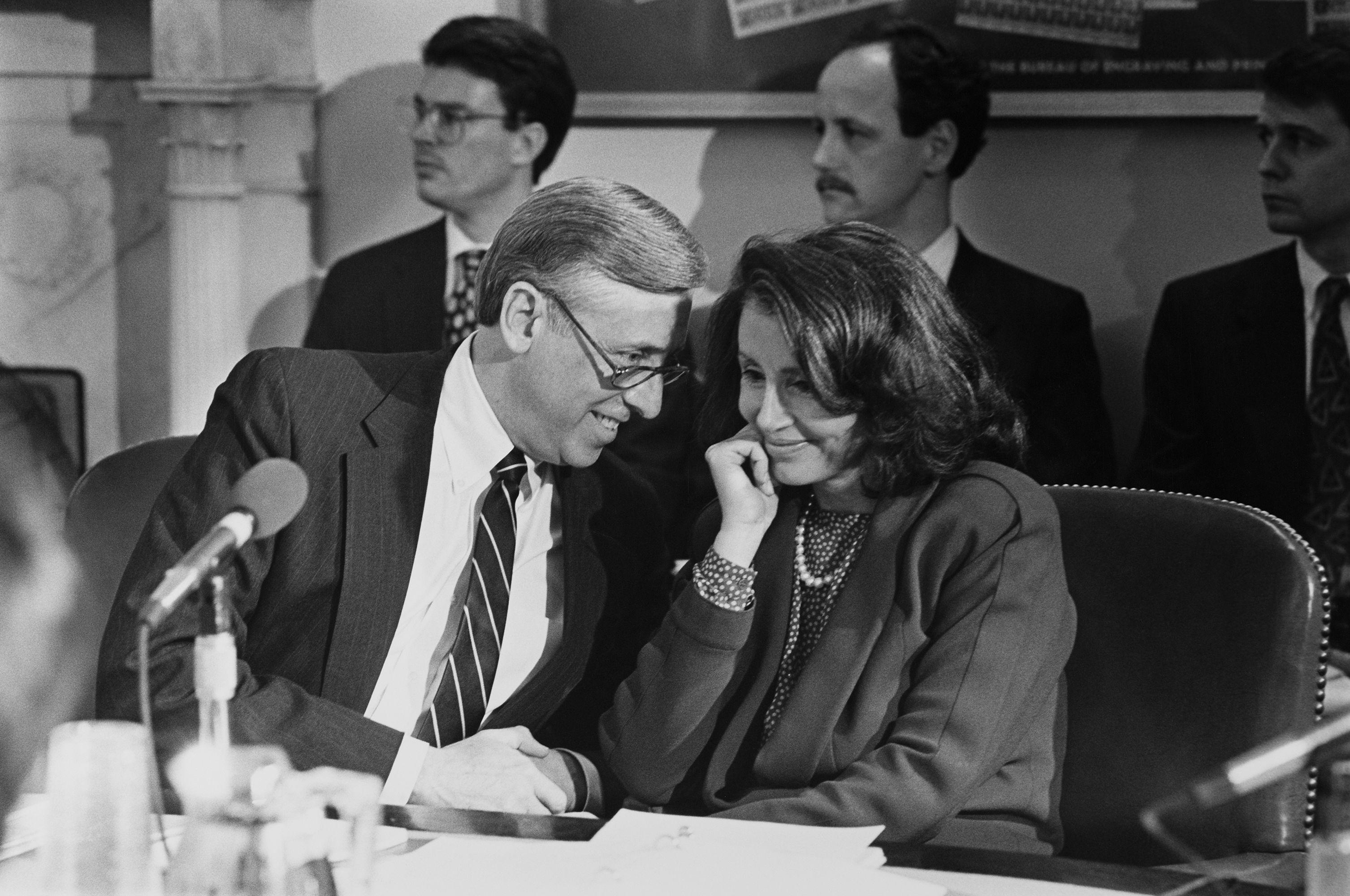 Representative Steny Hoyer and Pelosi chat.