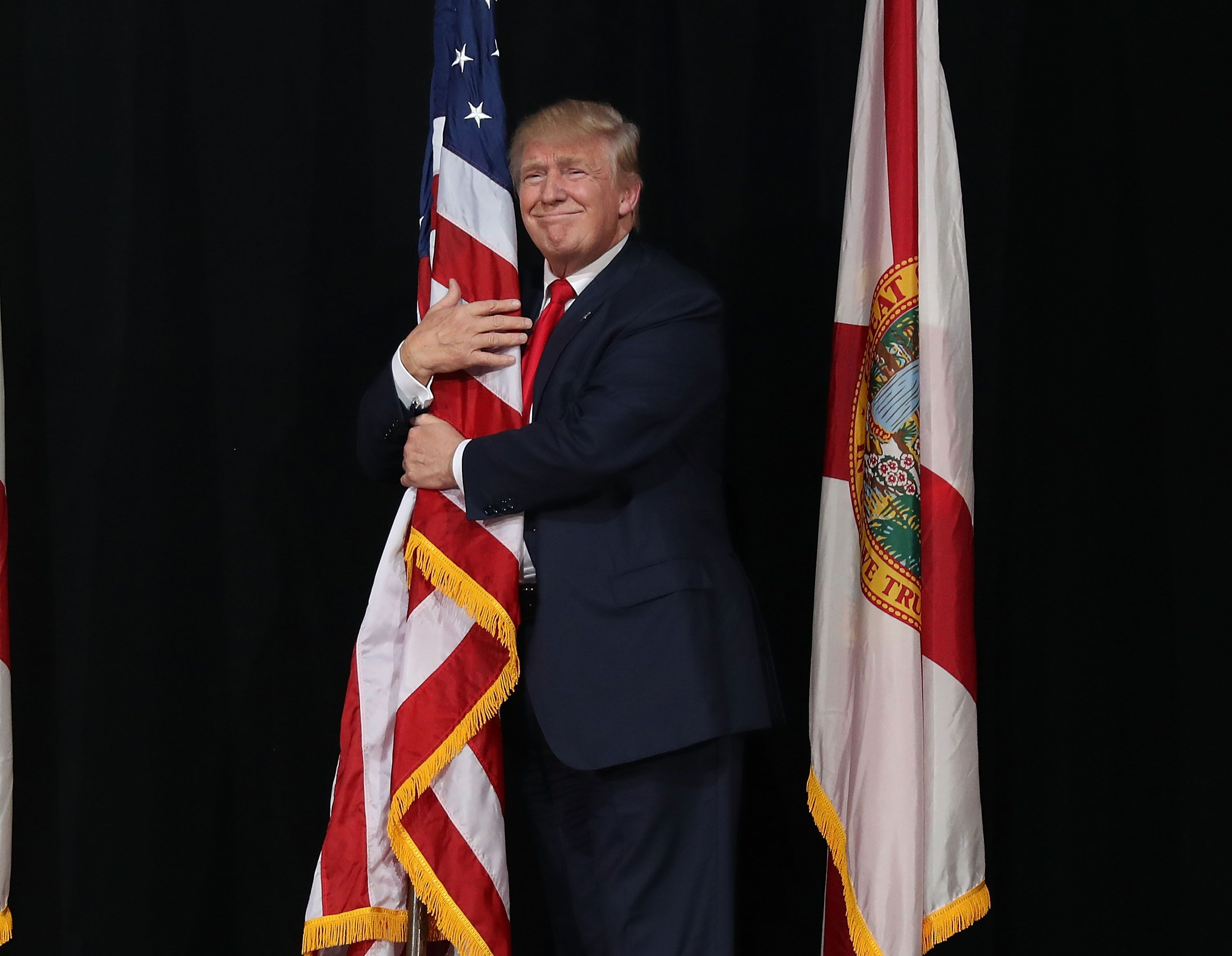 To Celebrate Flag Day, the White House Tweeted a Weird Picture of Trump Hugging Old Glory