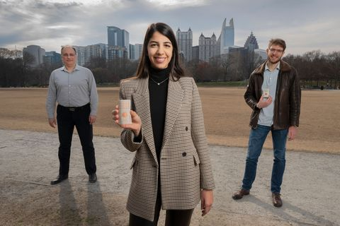 researchers at georgia tech hold up their rotman lens rectenna