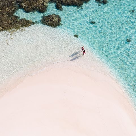 Overhead view of couple on a beach, Maldives