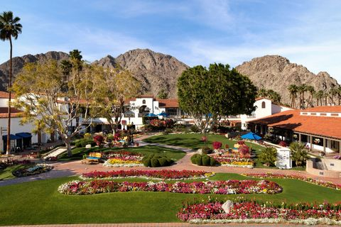 overhead shot of the hotel property with grass and pink flowers, overlooking the mountains