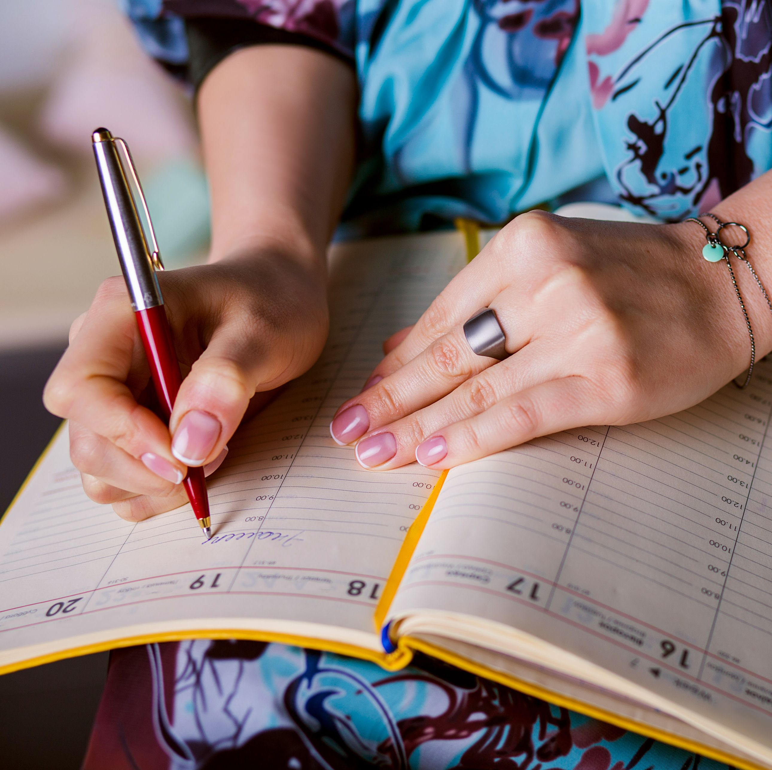 respectable woman is writing notes and planning schedule.