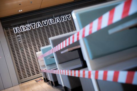 20 april 2020, hamburg a restaurant in the europa passage hamburg is still closed in the early morning, the seats in front of it are cordoned off with flutterband numerous retail shops up to 800 square meters are allowed to open again as of today photo christian charisiusdpa photo by christian charisiuspicture alliance via getty images