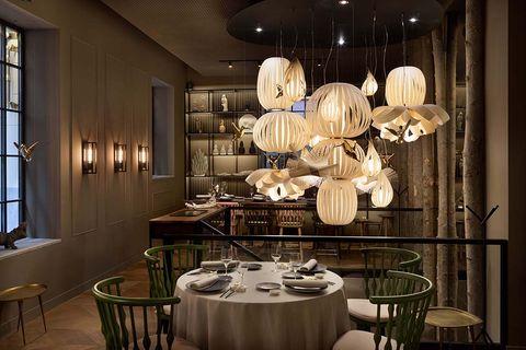 Lighting, Dining room, Light fixture, Chandelier, Ceiling, Interior design, Room, Lighting accessory, Table, Ceiling fixture,