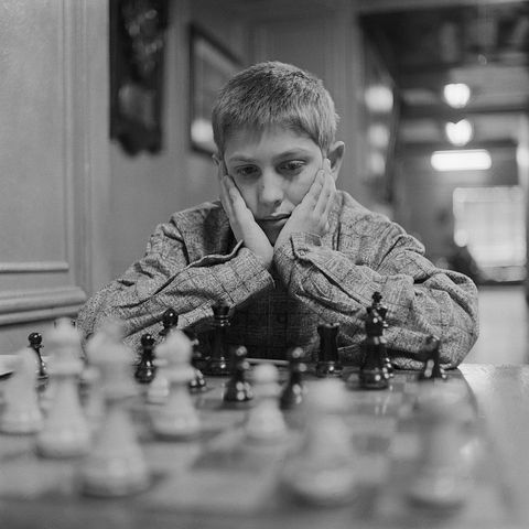 bobby fischer with hands on his face while concentrating