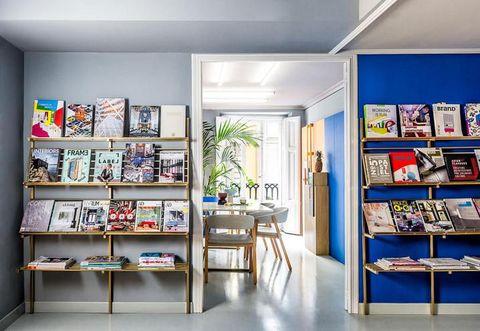 Room, Interior design, Shelf, Shelving, Furniture, Table, Wall, Ceiling, Floor, Bookcase,