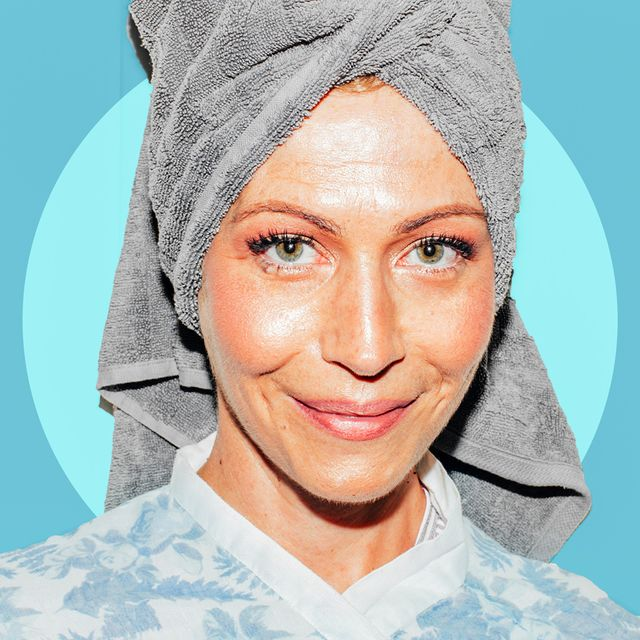 smiling woman in bathrobe and towel
