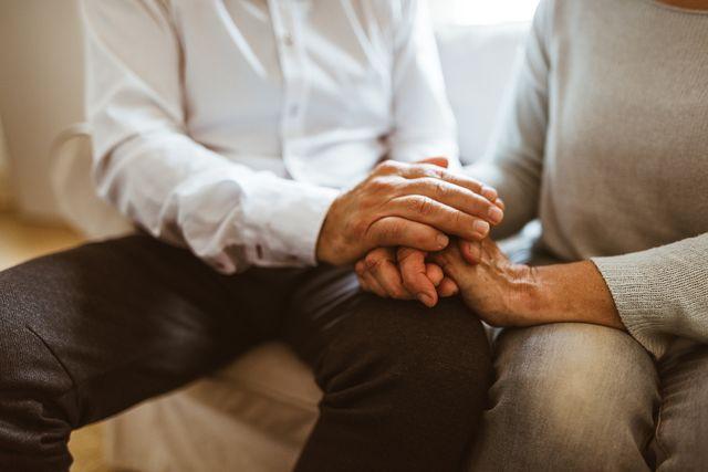 retirement couple holding hands