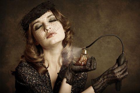 retro girl applying perfume