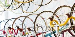 Retro Racing Bicycles Hanging In Bike Shop