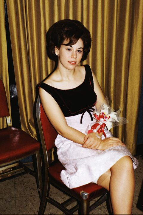 Woman in prom dress sitting in chair