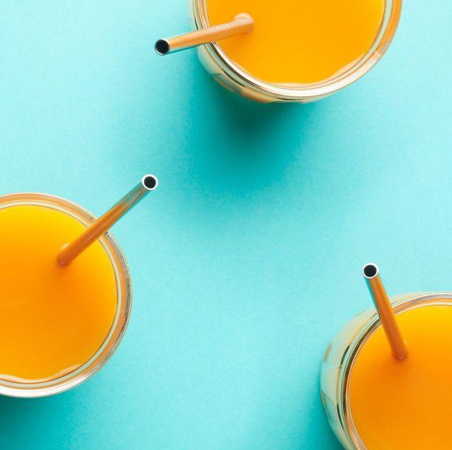 reusable metal straw in orange juice glasses
