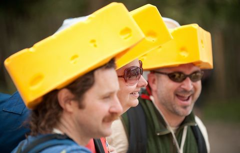 Revellers in cheese-shaped hats arrive a