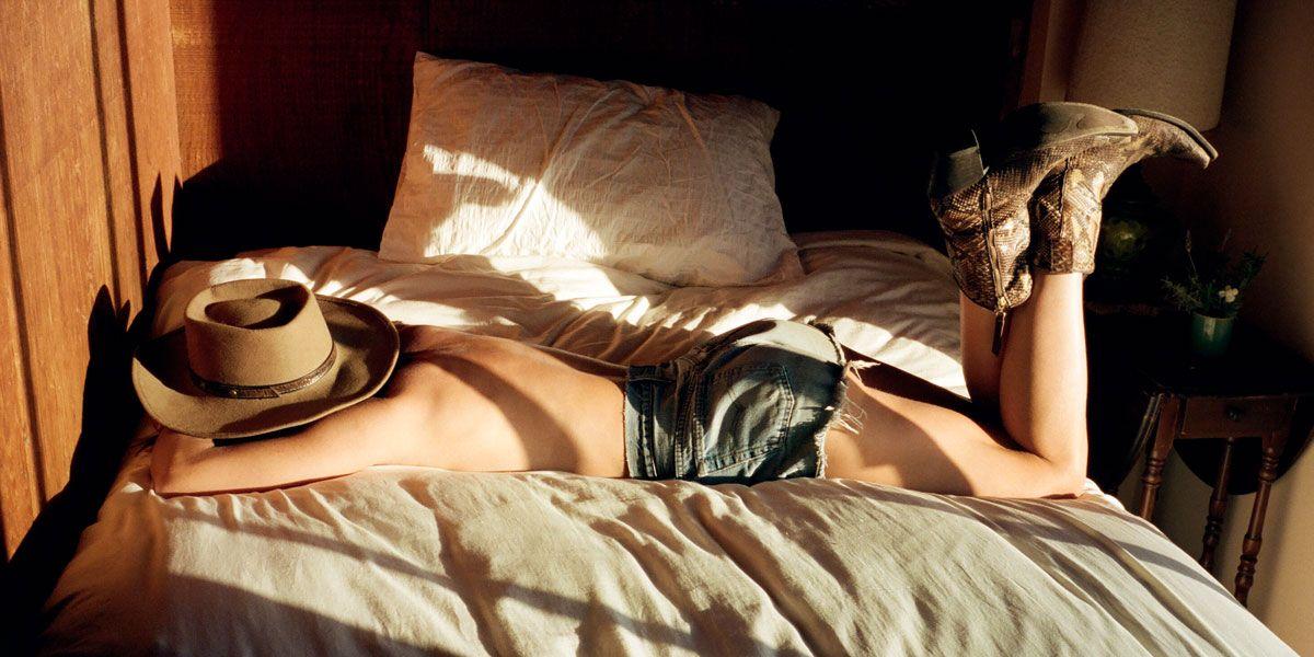 Black oiled nude woman