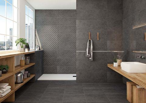 baño con revestimientos porcelánicos en color gris