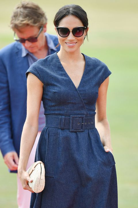 4f91f9a9c2 Meghan Markle Wears Summery Navy Blue Dress For Charity Polo Event